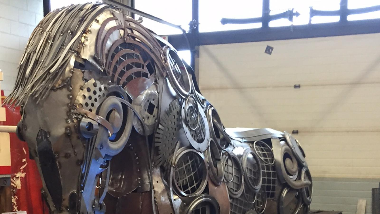 students create metal horse with blowtorches