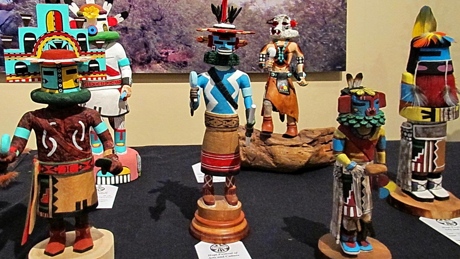 A display of colorful carved katsina dolls made by Hopi artists