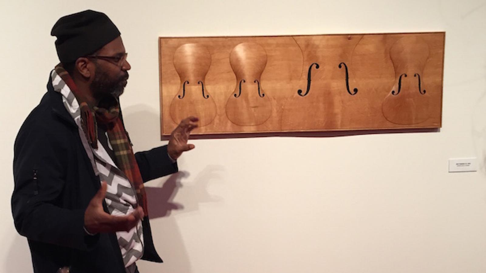 paul_rucker_explains_wood_carvings_during_art_studio_tour