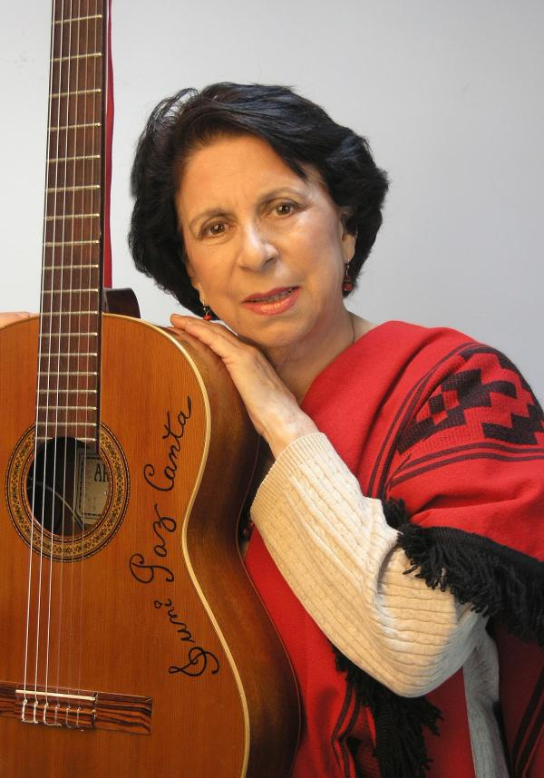 Woman holding a guitar.