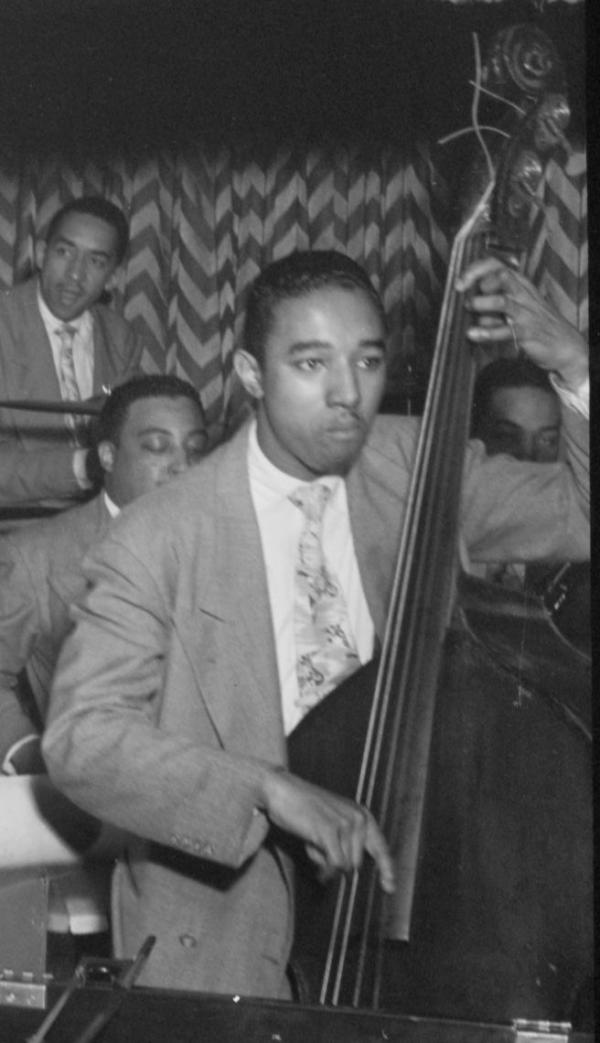 Man playing bass in a jazz orchestra.