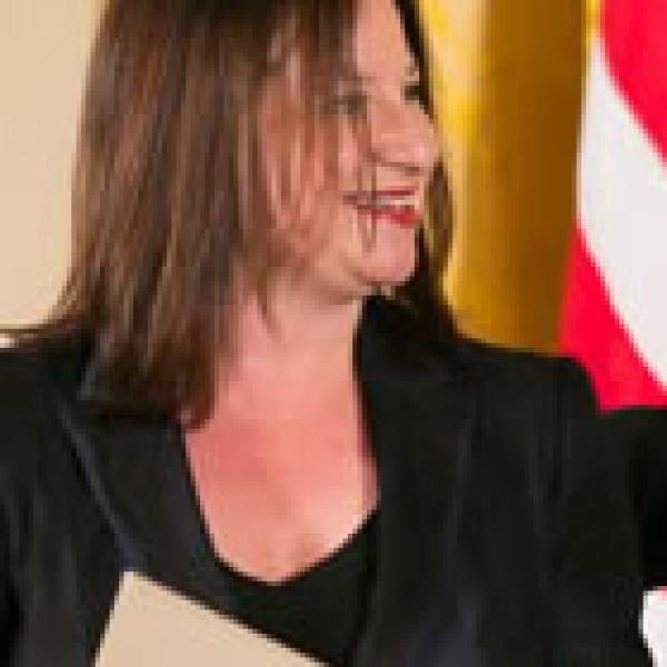 Jenny Bilfield, president and CEO of Washington Performing Arts Society, accepts the 2012 National Medal of Arts on behalf of the Washington Performing Arts Society from President Barack Obama