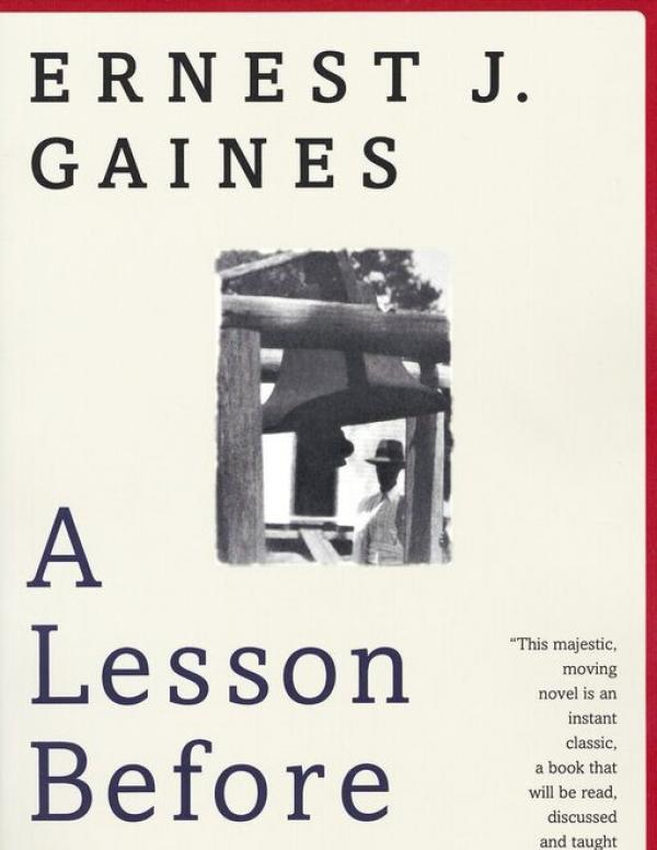 A Lesson Before Dying Book Cover - typographic layout with author name and book title with small image of an African American man standing beneath a wooden structure